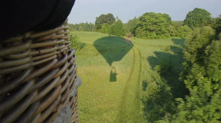 litvánia : Hot air balloon flying over forest Stock mozgókép