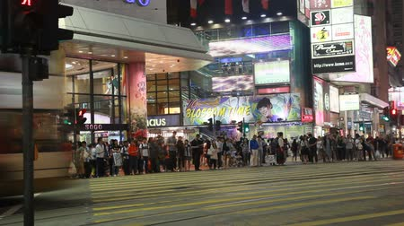 dark bay : HONG KONG - APRIL 16: A busy night street scene full of people and mobiles on April 16, 2010 in Causeway Bay, Hong Kong, China. Causeway Bay is one of Hong Kongs major shopping districts, with many shops open until well after midnight.   Stock Footage