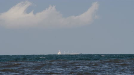 prosperita : Ship shape cloud and the ship at the sea speeded up motion