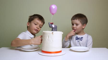 white elephant : A red banded birthday cake. Pastry shop advertisment. Children eating birthday cake.