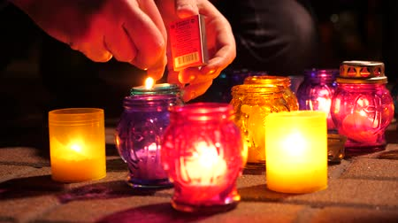 fiel : Candles commemorating murder victim. Remembrance day of all Faithful Departed, prayer for the dead. Pure Thursday. Holly Week. Burning candles in remembrance of victims of terror, act of terrorism Stock Footage