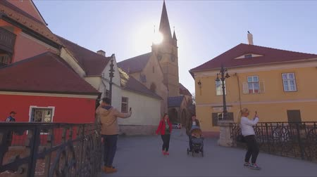 ismert : Tourism concept. Journey abroad. Migration concept. Transylvanian Saxon location. Walking through the streets of Sibiu, Romania. Attractive little-known places to visit. Unknown Europe Stock mozgókép