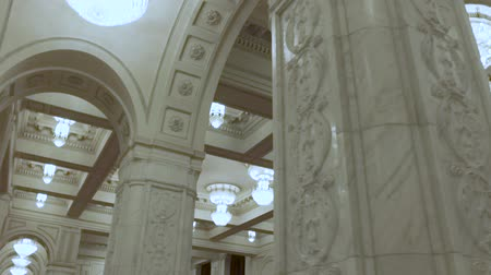 helyettes : Architecture and design. Classic interior with archs and molds. White colours of interior. Expensive chandelier in a chic style. Concept of luxury life. The video is suitable for the background Stock mozgókép