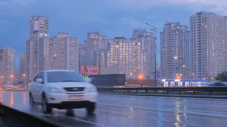 przesyłka : Transportation system. Logistics service. Consignment transportation. Bad weather on the road. International transportation. Car and truck lights on the road. International trucks on Ukrainian road Wideo