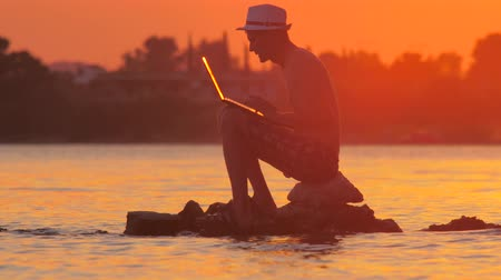 prestigious : Remote work background. Internet connection 3G 4G. Man with notebook on seashore. Male with gadget on seaside. Technology and travel. Working outdoors. Freelancer concept. side view