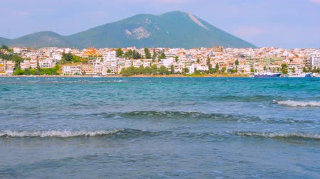 refugee crisis : View of Mediterranean sea from the ship going ahead to island. Travel background. Greek island with sea, mountain and buildings. City town of european island. Places in Europe where refugees arrive