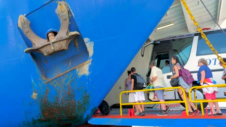refugee crisis : Tourists boarded on the ship, ferry boat. Travellers and cars loading on ferry boat to go to another greek island. Mediterranean ship, liner, ferryboat with travelers, tourists, refugees. Stock Footage
