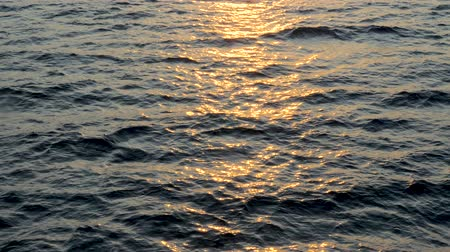 успокаивающий : Background of calm sea. Sea with little waves close up. Deep blue ocean with sun reflecting in the water.