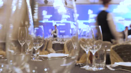 lavish : A waiter sets the table in a restaurant before customers arrive, and uses fine cutlery and glasses. Concept of: catering, design, romantic dinners. Luxurious catering background. Celebration idea Stock Footage