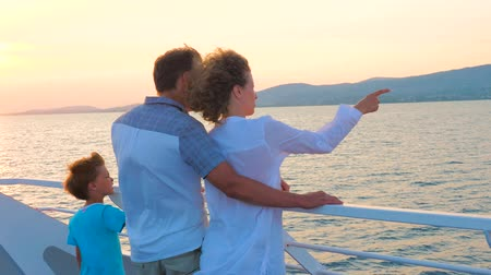 indicar : Family with one child. High season vacation. Christmas vacation concept. Positive emotions. Happy family traveling on sea transport. Love and support in family. Warm relationships Stock Footage