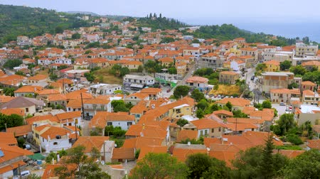 Top view of red roofs of houses, cityscape, Kymi, Greece. Tourism Europe Greece. Town in mountains top view. Architechture of old european city. Top view Wideo
