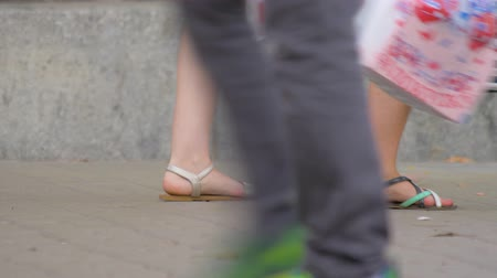 Peoples legs going on the street. Diversity of people. Group of people walk down the street. People in the busy city. Urban scene background. Concept crowd feet with shoes closeup