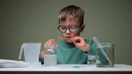 Little scientist doing experiments. Education concept. Child doing chemical research in laboratory. Dangerous experiment. Home activities for children. Preschooler interests