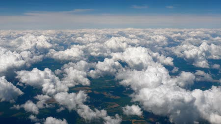 Flying over the clouds. Clouds and skyline horizon panoramic view. Aerial view of skyscape from plane. Fly over clouds. Traveling concept. Business trip. Breaking news. Returning home. Flight