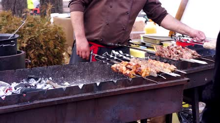 kebab : Street cook preparing meat on charcoal grill, outdoor cooking, barbecue party Stock Footage