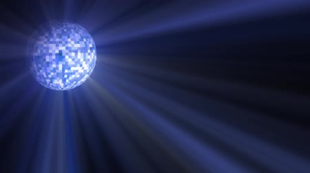 disko : Disco ball slowly turns with blue light ways shining from it.