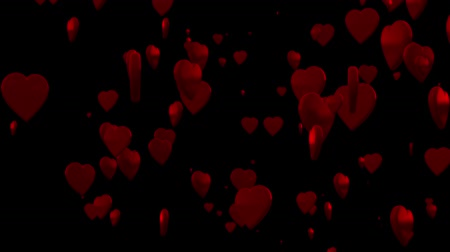 Shiny 3D hearts are rising against a black background.
