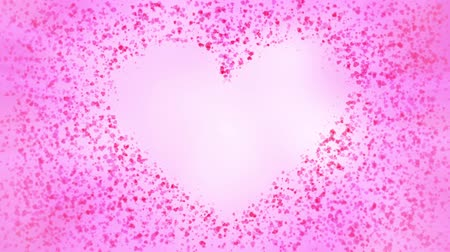 Small heart particles join to form a heart shape.