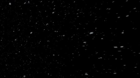 Snow continuously flies past the screen against a black background.