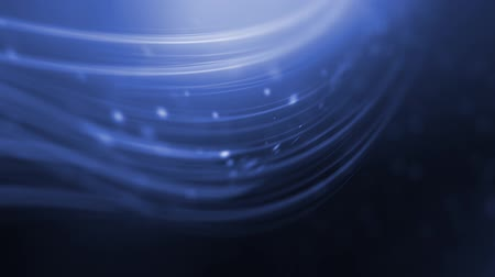 Some blue curved lines are gently moving and pulsating amidst a bunch of moving particles. Wideo