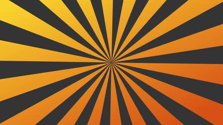An orange sunburst is rotating . Looping