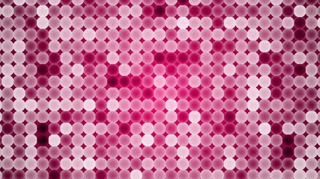 A grid of circles continuously change shades of red. Looping Wideo