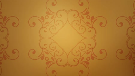 A flourish pattern slowly moves against a slow moving gold background
