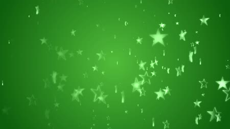 Stars continuously rise against a green background Wideo