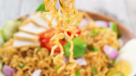 mi : Malaysian Spicy fried curry instant noodles. Ready to serve on wooden dining table setting. 4k footage video.