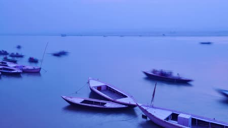 worship : Indian pilgrims rowing boat in dawn, Ganges river in Varanasi, India. 4k footage video.
