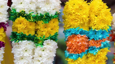 marigolds : Indian flower garlands for sales during diwali festival. 4k footage video panning or zoom. Stock Footage