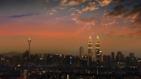 night scape : The capital of Malaysia, Kuala Lumpur city skyline in sunset view. 4k footage video panning or zoom.