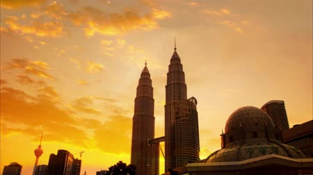 twin : Sunset view of Kuala Lumpur city skyline, Malaysia. 4k footage video panning or zoom.