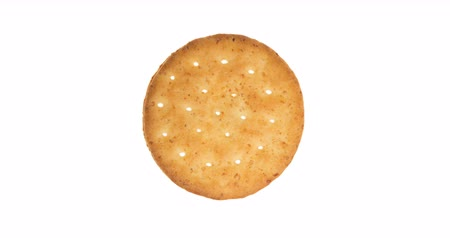 kepekli : Wheat cracker. A single piece wholemeal oat biscuit rotating, isolated on white background. 4k footage video. Stok Video
