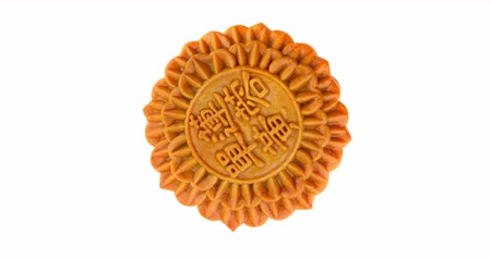 rotates : Seamless rotating Chinese Moon cake over white background, Chinese words on the mooncake means single yolk lotus. 4k footage video.