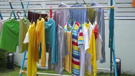 kurutma : Clothes drying on the clothesline outside on a sunny day, footage video. Stok Video