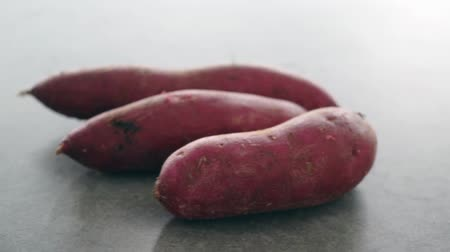 turn table : Pile sweet potatoes rotating, slow motion footage video. Stock Footage