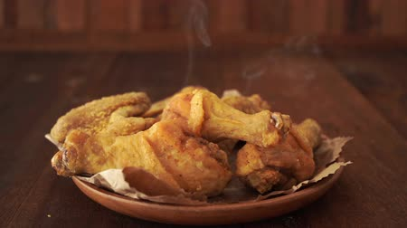 gevrek : Plate full of original recipe fried chicken on brown background. Stok Video