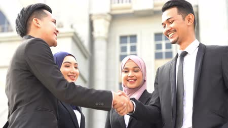 Businesspeople hand shaking, standing in front office building, multiracial business concept. Стоковые видеозаписи