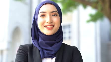 Beautiful Muslim business woman smiling. Стоковые видеозаписи