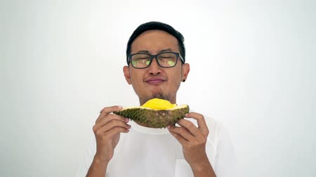 mal cheiroso : Man love durian smell, on white background.