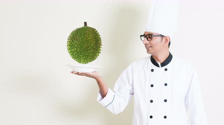 exotic dishes : Chef holding a plate with durian floating and rotate above. Cinemagraphs concept. Stock Footage