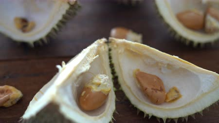 unpleasant smell : Leftover durian, shells and seeds on table.