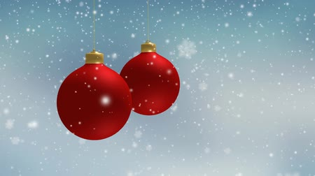 Winter blurred Christmas background with falling snow and hanging red Christmas decorations, balls, baubles. Slow motion festive 3D animation, full HD.