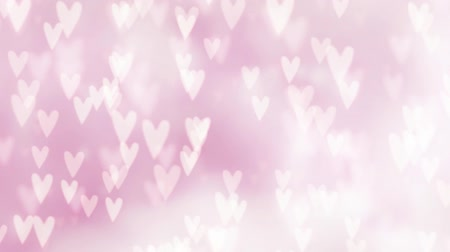 Valentines day or wedding abstract blurred background with falling hearts. Glittering bokeh lights. Love concept. Festive graphic HD animation. Stock mozgókép