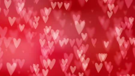 Valentines day or wedding abstract blurred background with falling red hearts. Glittering bokeh lights. Love concept. Festive graphic HD animation. Stock mozgókép