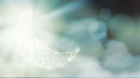 arabština : Glittering ornamental moon with moving clouds bokeh effect.  HD graphic animation for Muslim holiday holy month Ramadan Kareem.
