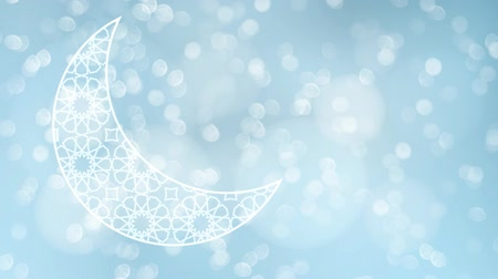 Ornamental Arabic half moon with glittering bokeh lights on the blue blurred background. Loopable Ramadan graphic animation.