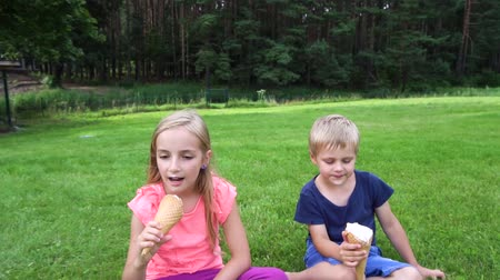 lambida : two kids eating icecream outdoors