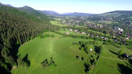 farmhouse : aerial view of green mountains valley
